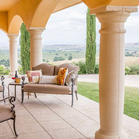 Bask in the warm sunlight and take in the endless views as you sip your morning coffee on the front covered patio.
