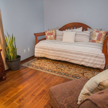 Bedroom 3 holds a comfortable trundle bed that can be set up as 2 twins or converted to a king bed, and is accented with cherrywood doors that can be found throughout the home.