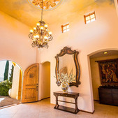 Upon entering, you are greeted by travertine tiles, Central Coast sunlight and a beautiful Italian collectible chandelier supported by a hand painted el Fresca ceiling.