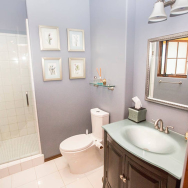 A full bath with glass top sinks is just off the kitchen and bedroom 3.