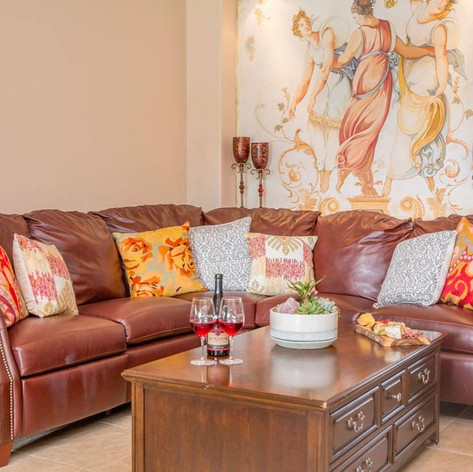As you travel towards the kitchen, a second living space holds a wrap around leather couch and recliner with a TV and fireplace for family fun and entertainment.