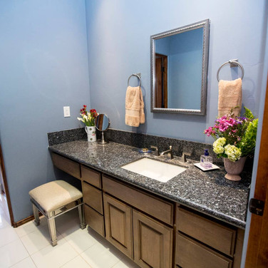 Bedrooms 1 and 2 share a full bathroom with a large walk-in shower and a beautifully tiled extra deep soaking tub, perfect for relaxing in our Villa.