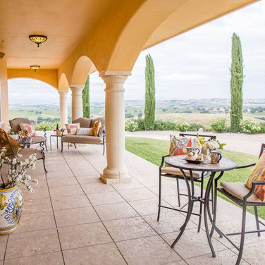 Step outside onto the covered paved patio with bistro table for two and two chairs and two love seats to sit and enjoy the views of Central Coast wine country.
