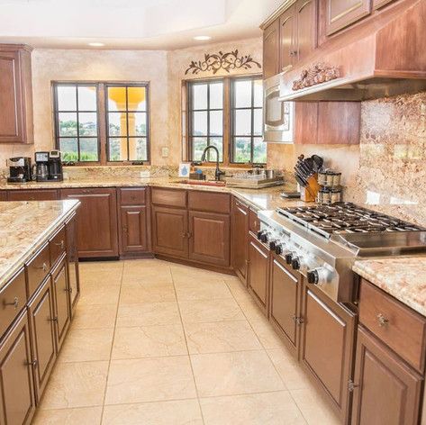 The kitchen is fully equipped for the chef in your family with granite countertops, a Wolf 6 burner range, large dual ovens, microwave, toaster oven and pantry.