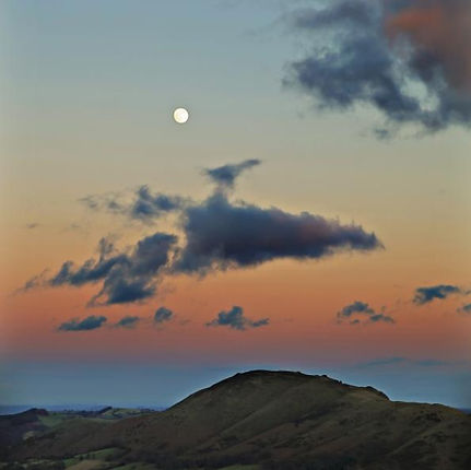 Winter Moon over Caradoc sunset  by Tim