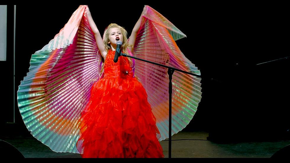SAM_PIO_SINGING_RED_DRESS.jpg