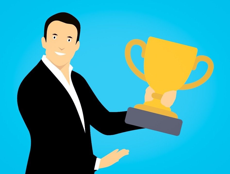 Illustration of a man holding a trophy cup