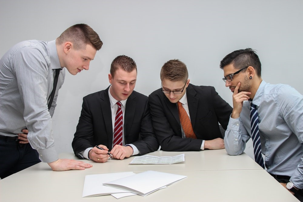 business innovation consultants reviewing customer insights