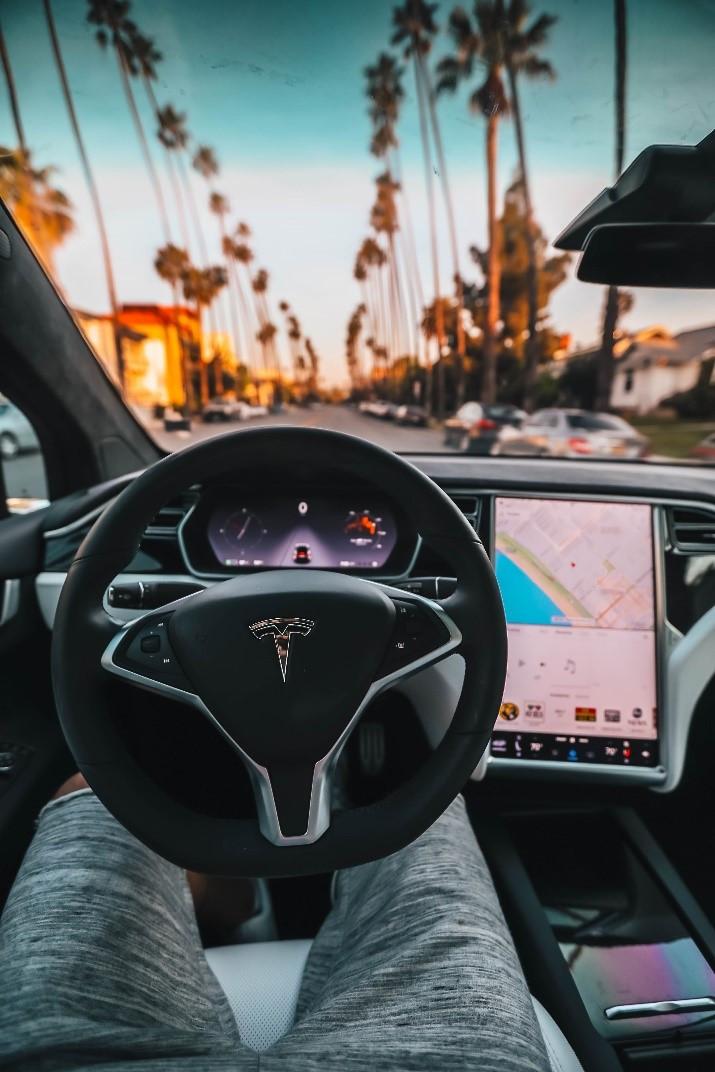 participant exploring Tesla's features during concept testing