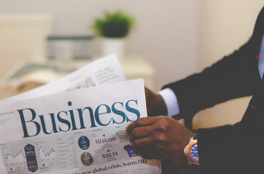 Man holding a business newspaper