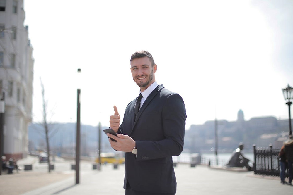 A happy business owner giving the thumbs up