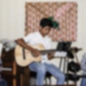 Guitar Player Looking Down.jpg