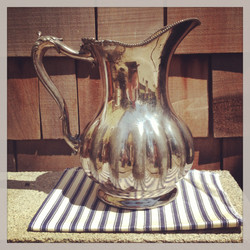 {Scalloped Silver Pitcher}