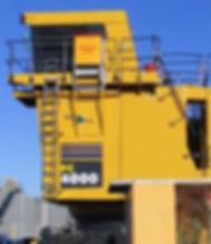 Mining shovel vertical escape chute