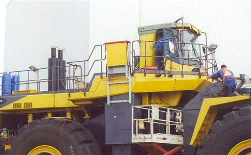 Mining loader vertical escape chute