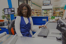happy-positive-female-cashier-working-gr