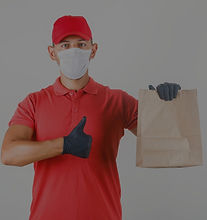 delivery-man-holding-paper-bag-showing-t