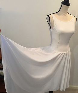 white swing low skirt.jpg