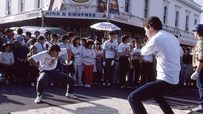 Electric boogie break dance at the 1983 Lygon St Festa. Picture: Rennie Ellis/State Library of Victoria