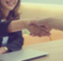 close up businesswoman handshake with pa