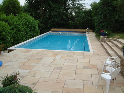 Outdoor Pool with behind bench automatic safety cover