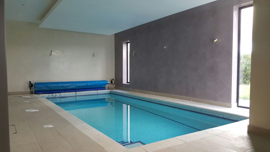 Indoor Pool with Bubble Cover and Cover Roller