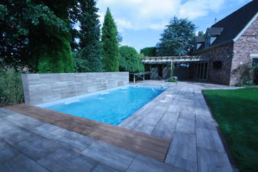 Outdoor Liner Pool with Automatic Cover hidden under decking lid