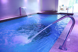 Indoor Freeboard Pool with Water Features & Spa
