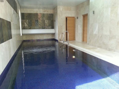 Indoor Deck Level Pool with wall hung automatic pool cover