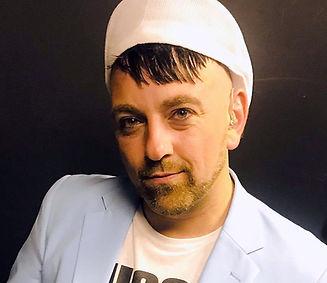Rusty O'Neil-pale blue jacket-white trendy hat