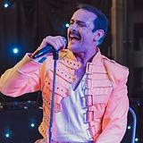 Mark Sanders as Freddie Mercury - classic yellow jacket