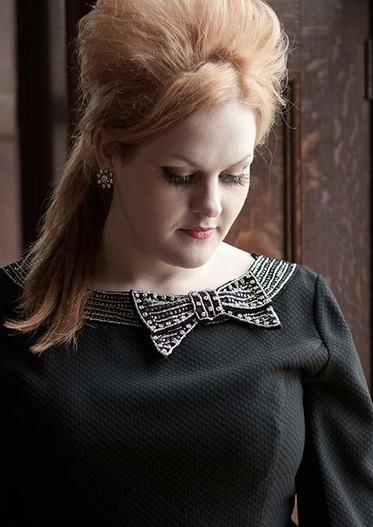 Natalie Black as Adele
