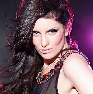 Rachel Silva- hair blowing looking straight into camera