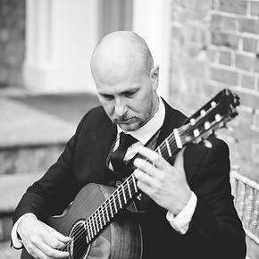 Alex Lloyd Williams - classical guitarist - playing guitar