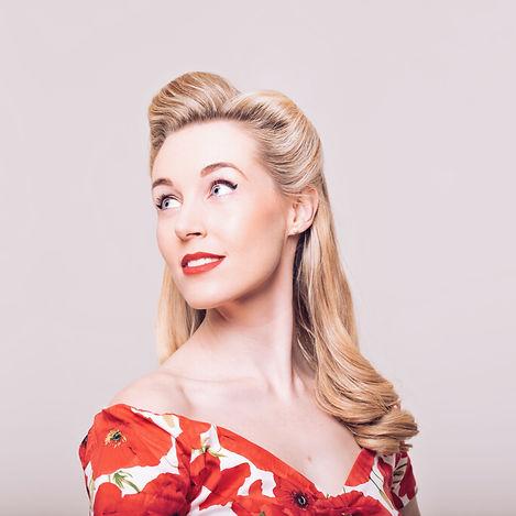 Miss Beth Belle - red dress - looking over shoulder - Vintage Vocalist