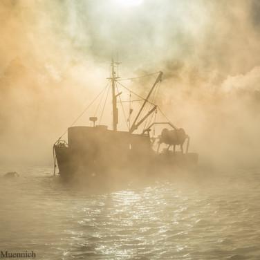 Fishing Boat in Sea Smoke.