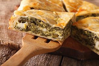 Greek spanakopita piece of pie on the ta