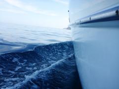 Disturbing the glassy sea.JPG