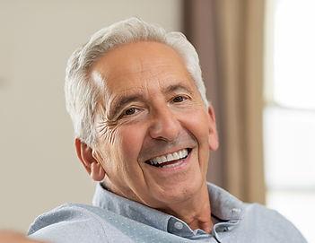 senior-man-smiling-at-home-7BCU8E6_edite