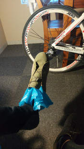 Make-shift wind-proof socks with grocery bags, to help with freezing toes in the morning.