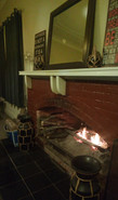 Nights were cold. The hotel I was staying at got their fireplace going. — at Mendooran Royal Hotel.