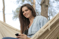 Canva---Woman-Sitting-on-Hammock-While-L