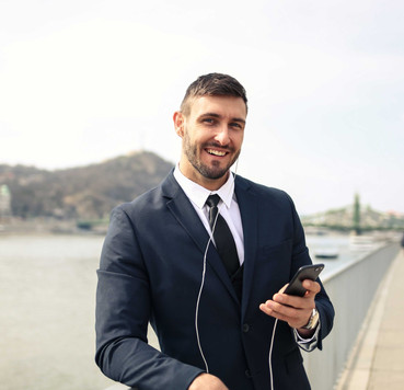 Canva---Man-in-Black-Suit-Jacket-Holding