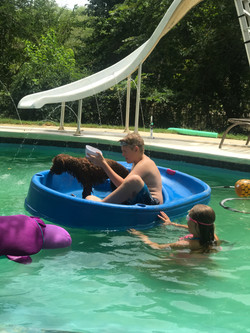 Boating with my boy in the pool.