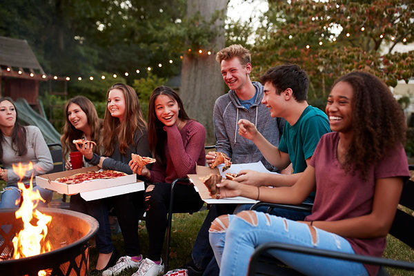 teens-eating-teenagers-pizza-camp-fire-1