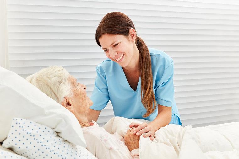 Caring geriatric nurse cares for ill sen