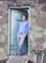 artist standing in doorway