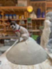 dog sitting on sculpture