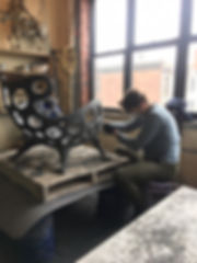 man working on building a chair