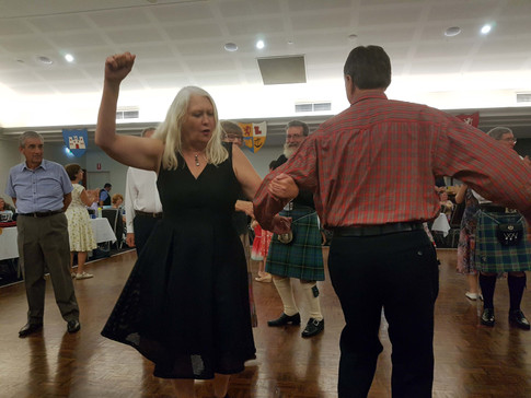 """Dancing """"Strip the Willow"""" to the pipe band"""